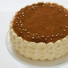 Tiramisu birthday cake with piped swirl ruffle sides - vanilla cake soaked with espresso syrup and layered with kahlua cream cheese filling