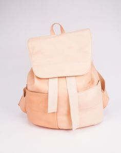 Back to school never looked so good as it does with this barely-there peach toned leather backpack by YUE.