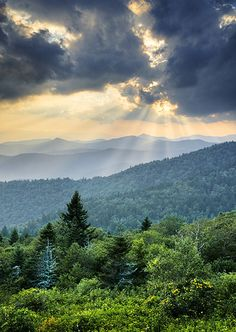 Rays of light over the Blue Ridge Mountains. each ray a different size and length. The clouds make a beautiful Gobo.-k