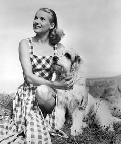 English film actress, Ann Todd, and adorable terrier dog