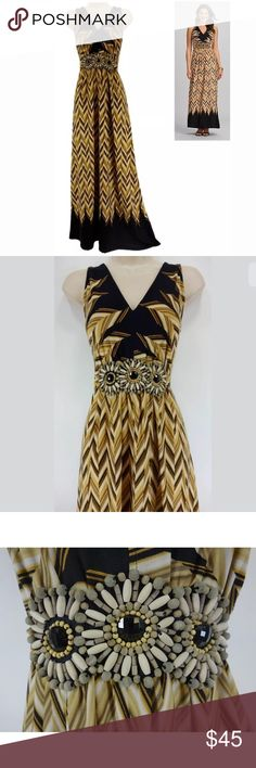 "14 Large XL▪️GOLD/BLACK JEWELED CHEVRON MAXI DRESS We LOVE this gorgeous, chevron maxi dress!   Size: 14 Slip on/off V-neckline Gorgeous chevron print in gold, black,& white Waist is embellished w/ jewels & beads Adjustable tie at the back of the waist Stretchy, comfortable fabric Measurements: Bust (armpit to armpit): 40"" relaxed - stretches to 49"" Waist: 35"" relaxed - stretches to 42"" Hips: 51"" relaxed Length: 58.5""  (top of shoulder to bottom hem)  Condition: EXCELLENT CONDITION! Fabric…"
