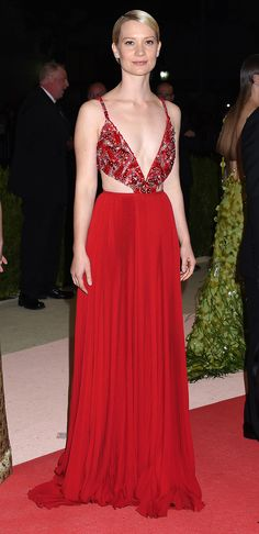 MIA WASIKOWSKA  wearing a lipstick-red Prada gown with a beaded bodice and pleated skirt and Fred Leighton jewels. Met Gala 2016