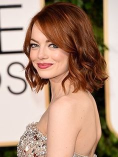 Emma Stone curled long bob with red lipstick | allure.com