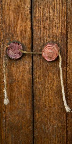 Two wax seals on a wooden door
