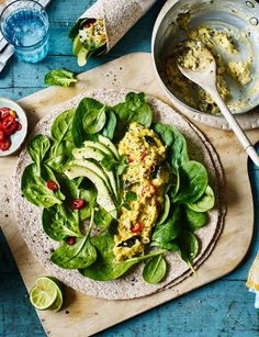 Scrambled egg wrap recipe with Indian spices, avocado and greens - a hearty vegetarian breakfast recipe, this healthy wrap is guaranteed to set you up for the day. Wrap Recipes, Egg Recipes, Light Recipes, Cooking Recipes, Breakfast Wraps, Indian Breakfast, Breakfast Recipes, Vegetarian Breakfast, Breakfast Ideas