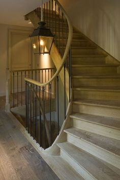 Stairs with lantern - I like how polished yet rustic and natural it seems