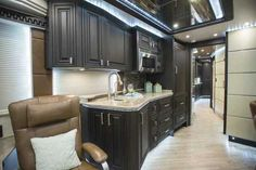 2016 New Prevost Emerald Class A in Florida FL.Recreational Vehicle, rv, This Emerald X3 is a complete Cherry Wood with a Chocolate Matte finish interior, the furniture is covered in Stargo Smoke Colored Leather all resting on a light wood floor. The layout is a modified side aisle with a dual entry bathroom, a large angled shower and enormous rear walk in closet. The appliances and audio/video equipment are all state of the art with full iPad controlled Crestron Remote Control systems.