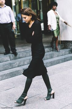 Full black midi dress plus sign + deep green olive sock knee-high boots mules heels
