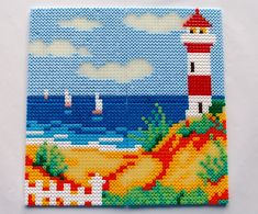The lighthouse on the beach hama perler beads by Nina V. Kristensen