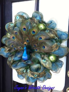 Peacock Wreath by Candy HighlandPeacock Wreath - this made me think of Jennifer Whittaker!A Peacock ChristmasMost beautiful wreath ever layed my eyes onNo tutorial, just inspiration pic Peacock Wreath, Peacock Decor, Peacock Theme, Peacock Crafts, Peacock Ring, Peacock Colors, Peacock Feathers, Wreath Crafts, Diy Wreath