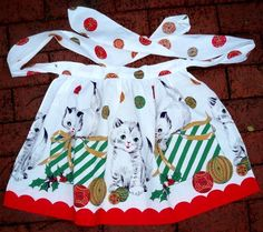 vintage apron with kittens.  I wish fabric companies would make more fabrics like this.