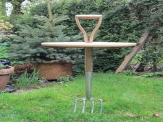 Garden fork table! :-)  Made using a garden fork and sourced the wood for the table from the off cuts at a local timber yard. The fork doubles up as a folding table and can also be used on uneven ground/sloping ground, simply dig in the ground and level it. Ideal for picnics, camping, BBQ's and garden etc. This is another repurposing/recycling projects.