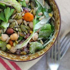 An easy throw-together lunchtime salad with beans and chickpeas, plenty of crunchy fresh veges, and a tahini drizzle dressing.