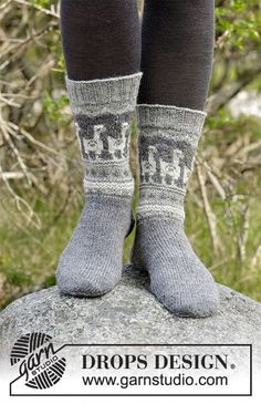 Andean Caravan Socks - Knitted socks with multi-coloured Nordic pattern. Sizes 35 - 43. The piece is worked in DROPS Nord. Free knitted pattern DROPS 184-20