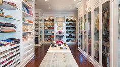 The glass doors give this closet a museum-worthy display.   - HarpersBAZAAR.com
