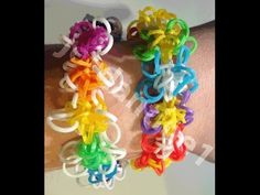 New Rainbow Loom STAR SWIRL FLOWER Bracelet - (One Loom or Two) Designed and loomed by jordantine1. Click photo for YouTube tutorial.