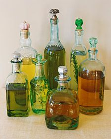 Save your pretty glass bottles from olive oil or liquor and replace the caps with craft store corks and drawer pulls. Pretty!