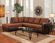 Chaise Sectional Sofa | The contemporary style of this chocolate brown chaise sectional sofa adds comfort and style to your home's living room. The track arms complement the fabric in the seating areas and the faux leather of the base and arms. This sofa features loose back pillows to provide comfortable seating.Relax on the smooth brown microfiber that adorns the seat and backrest pillows. A sleek and easy to clean faux leather covers the lower frame and boasts a white accent stitch.