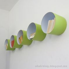 DIY - Shelves from old paint buckets. Maybe cover the edges and inside in a soft fabric for kids room.