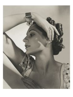 Vogue - October 1936 - Woman Dripping with Jewelry Poster Print  by Horst P. Horst at the Condé Nast Collection