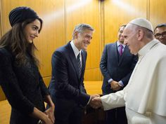 George and Amal Meet Pope Francis! The Clooneys Honored for Charity Work at the Vatican http://www.people.com/article/george-clooney-amal-clooney-meet-pope-francis