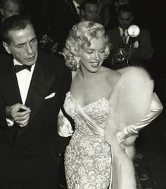 Marilyn Monroe - November 4, 1953 with Humphrey Bogart and Lauren Bacall (not visible) - attending the premiere of How To Marry A Millionaire