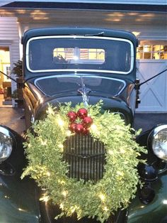 """A """"new"""" 1935 Ford truck, perfect in British green for the holidays, complete with a lit tree in the open back!"""