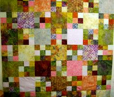 Batiks, solids blocks and nine Patches.  This might have been the one I gave to Christine.  PL