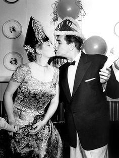 Nothing funny here: I Love Lucy comedy duo and real-life couple Lucille Ball and Desi Arnaz celebrate New Year's Eve together with all the trimmings – and a kiss! – in the 1950s.