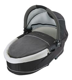 Quinny Dreami Bassinet for Buzz Stroller, Storm. Converts buzz 3 strollers for pram use. Locks in and out of the buzz frame for easy portability. Adjustable canopy doubles as a carry handle. Three point harness. Includes bug net, rain shield, and fleece blanket.