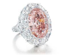 Ring with 12.85-carat fancy intense orangey pink diamond