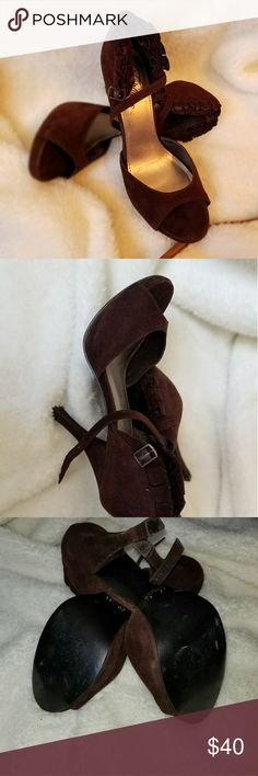 Fergie Sandals These cute brown sandals can add a little prissy to your outfit. Check out the details around the back of the heels. I love the little ruffles that add an accent to the overall shoe. Minimum wear but haven't worn in years. Give these cuties a home. Will consider all offers Fergie Shoes Sandals