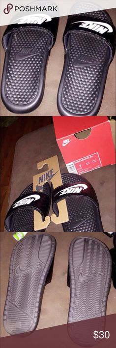 Nike Woman's slide sandals size 7 NEW! Worn once indoors. Size 7. Black. With box and hanger. Nike Shoes Sandals