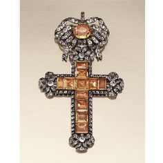 PASTE PENDANT, PORTUGUESE LATE 18TH CENTURY Designed as a Latin cross, suspended from a tied ribbon bow surmount, similarly decorated to the cardinal points, set with foil backed table-cut and cushion-shaped paste of yellow tint, highlighted with circular-shaped near-colourless paste