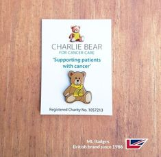Lovely 'Charlie Bear' fund raising badge with attractive backing card, black dye plated detail with soft enamel & shiny epoxy coat.