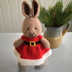 This little bunny looks like Santa's helper! The Knit Picks Glimmer Stroll yarn gives the outfit a perfect holiday sparkle. I did a few extra modifications to create a dress with a lower wai...