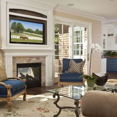 traditional living room by Brownhouse Design, Los Altos, CA. Is it a good idea to put tv over fireplace? Tv Over Fireplace, Family Room Fireplace, Home Fireplace, Fireplace Surrounds, Fireplace Design, Fireplace Ideas, Fireplace Stone, Double Fireplace, Fireplace Mantels