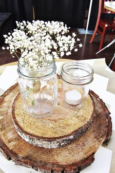 Wooden centerpieces, mason jars and baby's breath for baby shower.  Would be cute to wrap jars with burlap bow with a touch of blue or pink added in.