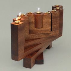 Items similar to Menorah on Etsy Menorah by OriAroesti on Etsy. A menorah that expands into a variety of different positions in space (made of mahogany with brass candle cups). Very mid-century modernish. Candle Cups, Candle Stand, Wooden Projects, Wood Crafts, Wooden Candle Holders, Diy Holz, Wood Creations, Tea Light Holder, Wood Design