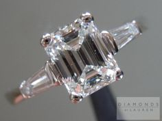 14Karat White Gold Diamond Ring    WEIGHT: 1.21ct  SHAPE: Emerald Cut  COLOR: G  CLARITY: SI2  MEASUREMENTS: 6.83 x 5.29 x 3.61 mm  TOTAL DEPTH: 68.2%  TABLE SIZE: 62%  POLISH: VG  SYMMETRY: VG  FLUORESCENCE: NONE  GIA REPORT #: 2111096578    SIDE STONES:  TOTAL WEIGHT: 0.23cts  QUANTITY: 2  SHAPE: Baguette  COLOR: G  CLARITY: VS2    MOUNTING:  14Karat White Gold