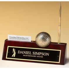 Our Golf Name Plate features a rosewood piano finish nameplate with a pen, business card holder, and gold-tone metal golf ball clock. measures x in size and weights pounds. Desk Plaques, Desk Name Plates, Company Party, Gold Pen, Pen Sets, Business Card Holders, Desk Organization, Led Zeppelin, Clock