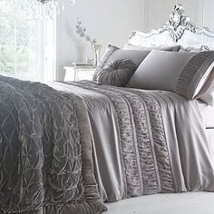 Silver 'Monroe' Bed linen - Debenhams.    This would be absolutely incredible on our bed - it matches our headboard!