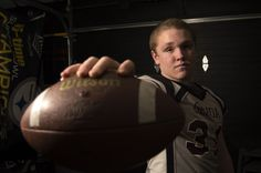 This is an environmental portrait of a high school football player at Genoa High School. I wanted to make his face the only thing in focus because the photo is all about him. The football gives the photo depth, while also framing his face, and showing some strength.