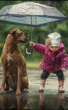 Not sure a child this size/age could hold an umbrella this way but it's a cute picture.