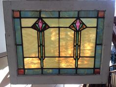Pair of antique Prairie School style stained glass windows