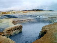 Hydrothermally altered crust and boiling pools of mud at the Hverir geothermal area in Northern Iceland