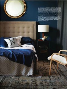 Love this dark paint on the wall for the bedroom and the upholstered headboard