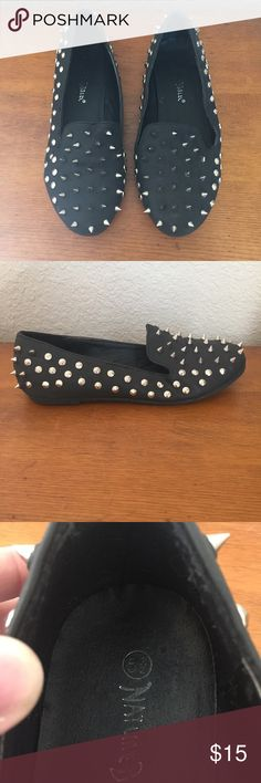 Studded Loafers (10) Black faux leather loafers with a combination of pointed and flat studs. Size 5.5. Bottoms are a bit dirty but no real signs of wear. Shoes Flats & Loafers