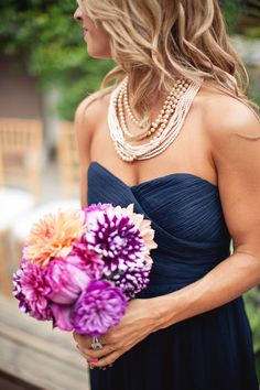 Navy bridesmaids dresses and gold statement necklaces - love for all the girls to be on navy? With the soft pearls and minty, whitey, corally flowers? If doesn't work have white dress all different!