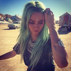 I love everything here, her pastel mint hair, camo tshirt with oversized jewellery and the bindi  x